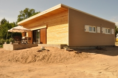 vivanbois-maison ossature bois-bardage bois mélèze-fibre ciment james hardi- menuiserie internorm en PVC et coulissant aluminium-bac acier- volet bois-soubran