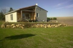 vivanbois-maison ossature bois-bardage cédral éterclin et mélèze-menuiserie pvc blanche-couverture tuile -lijardière