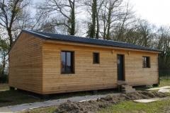 vivanbois-maison ossature bois-bardage mélèze-menuiserie aluminium laqué 7016-couverture bac acier-mescheers sur gironde
