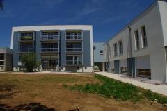 vivanbois- réhabilitation de l'ancienne gendarmerie en logements-bardage fibre de bois peint canexel - gémozac